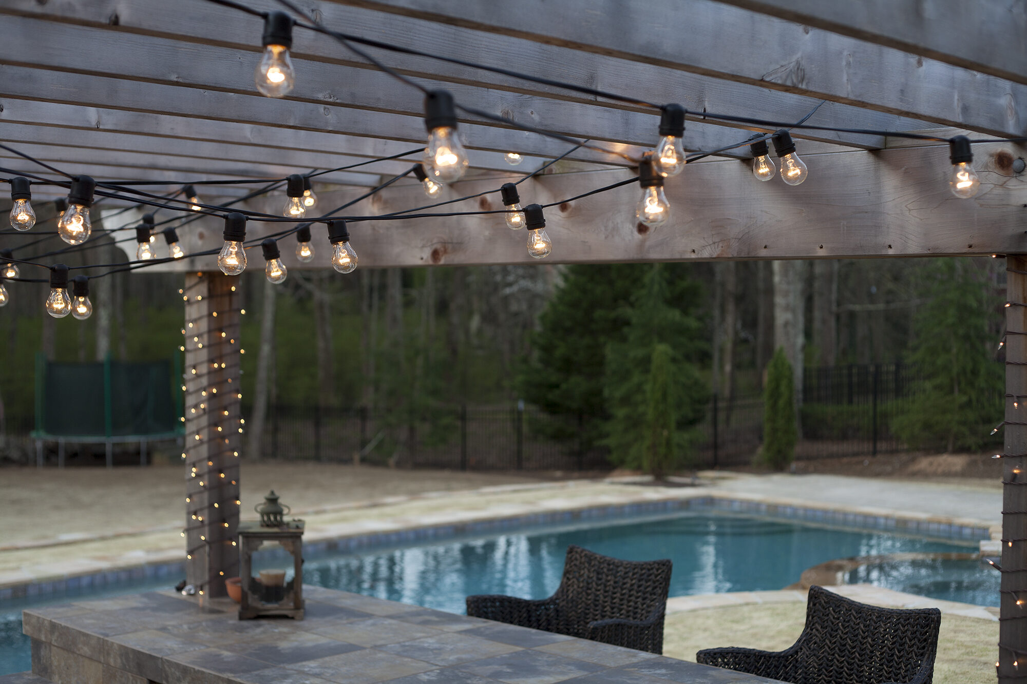 How To Hang String Lights Deck : Hanging Patio String Lights: A Pattern of Perfection - Yard Envy