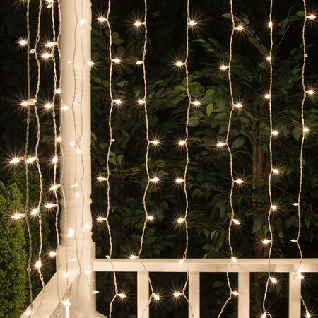 Hang mini lights and curtain lights outside for a unique outdoor lighting idea