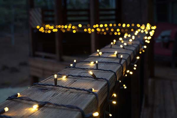 outdoor deck lighting. wrap white mini lights around the deck for a beautiful outdoor lighting idea g