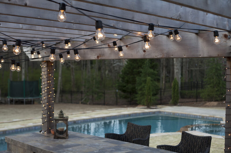 hang lighting. hang patio lights on the deck and by pool to create an inviting inspirational lighting