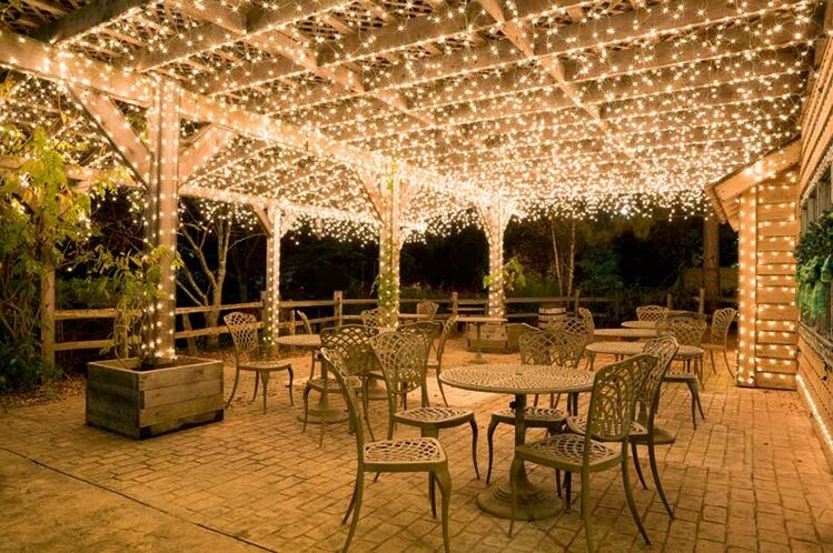 icicle lights shimmer across pergola ceilings - Perk Up Your Party With Pergola Lighting - Yard Envy