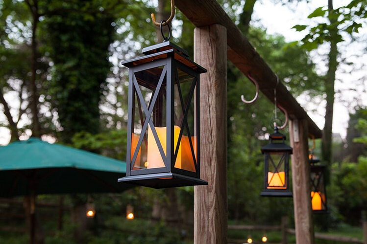 Hang candle lanterns from S hooks to illuminate the backyard quickly!