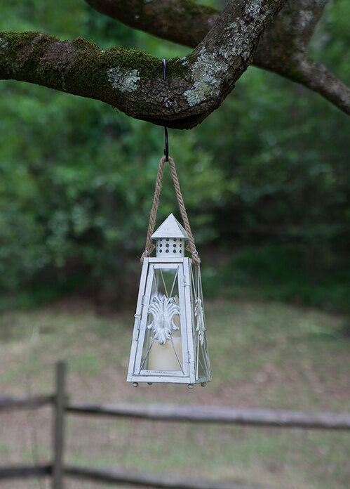 Hang Candle Lanterns during a backyard wedding or summer party for elegant lighting in no time!