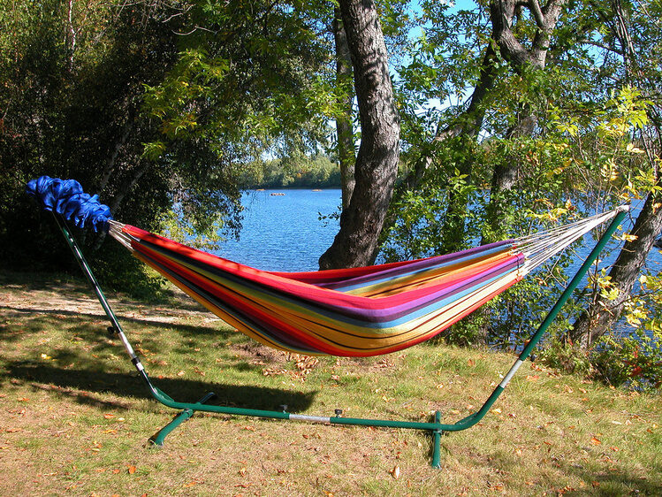 Hang a hammock in the backyard for you and your guests to enjoy the warm breeze!