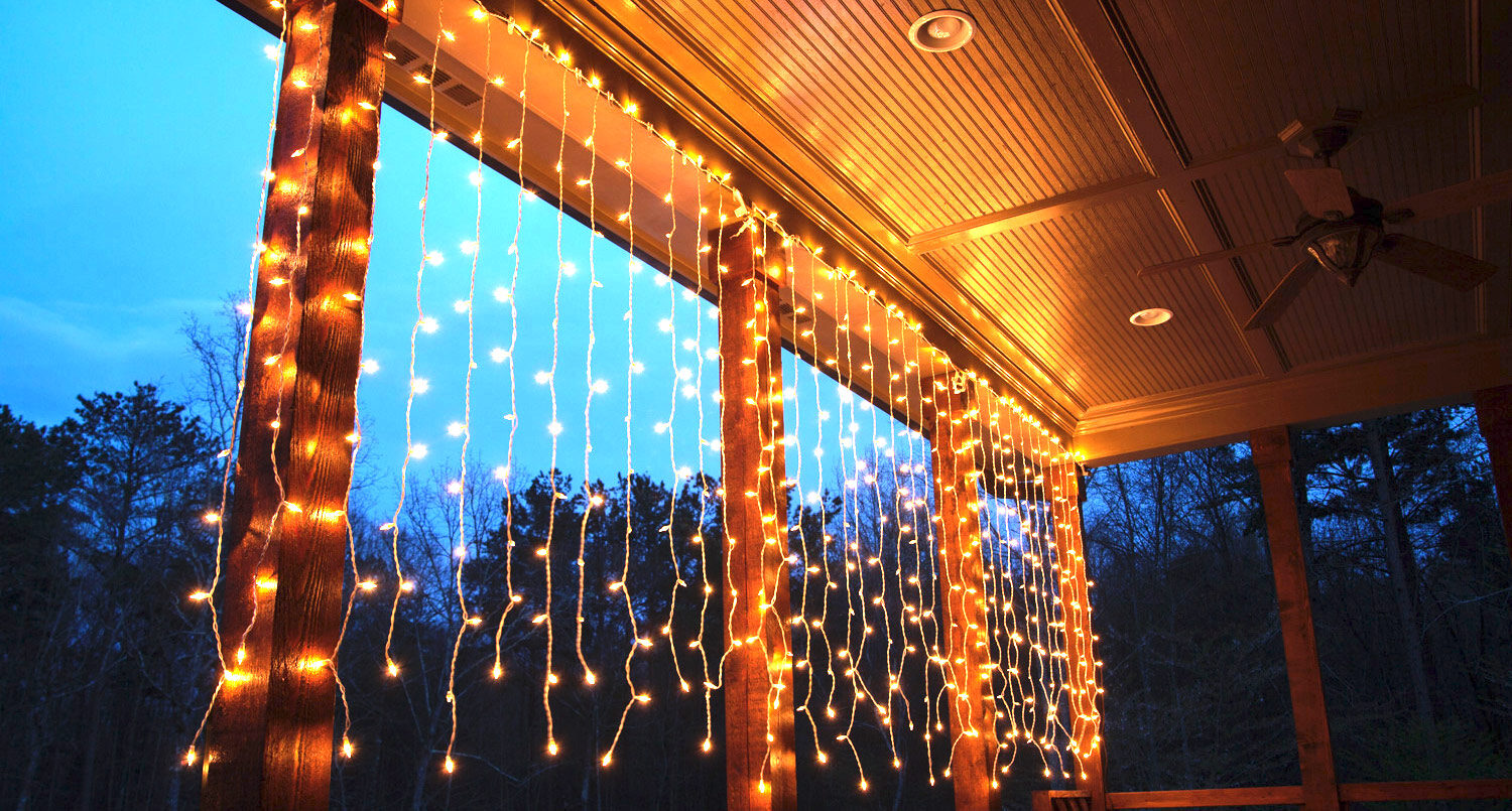hang curtain lights across the deck