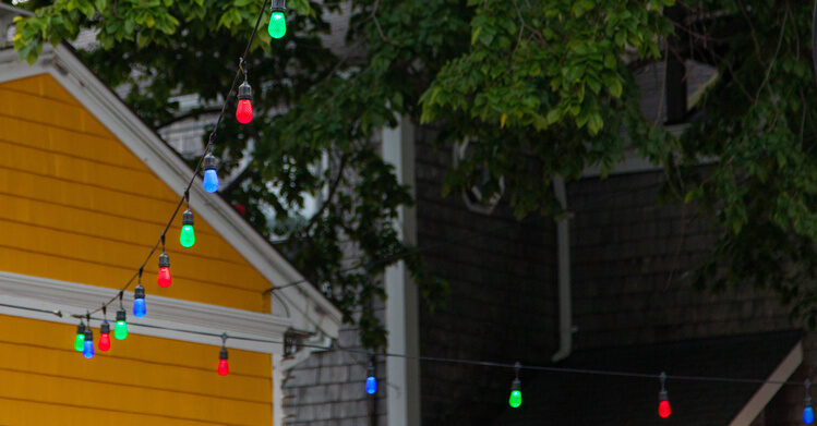 Hanging Colorful Patio Lights In The Backyard Makes Everything Brighter!