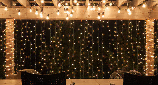 Patio String Lights Hanging From A Backyard Pergola