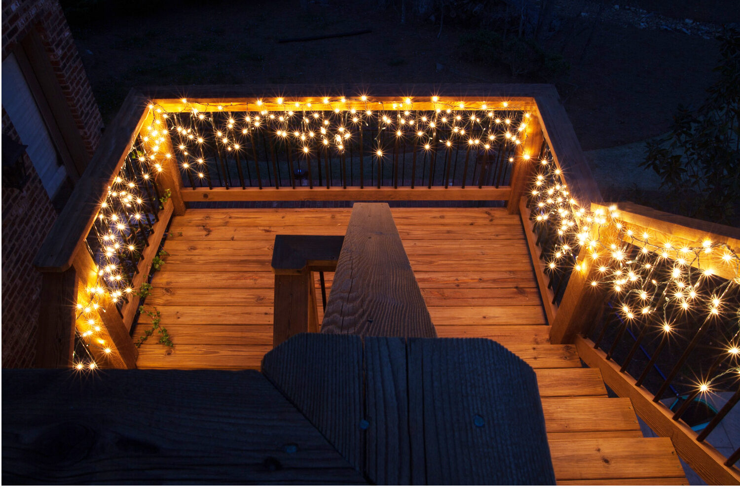 Icicle Lights Create an Inviting Outdoor Staircase & Deck Lighting Ideas with Brilliant Results! - Yard Envy