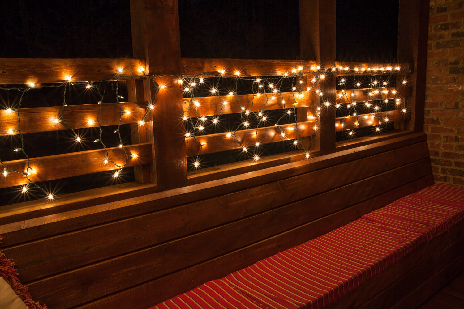 create beautiful outdoor lighting by hanging white lights from decks and patios