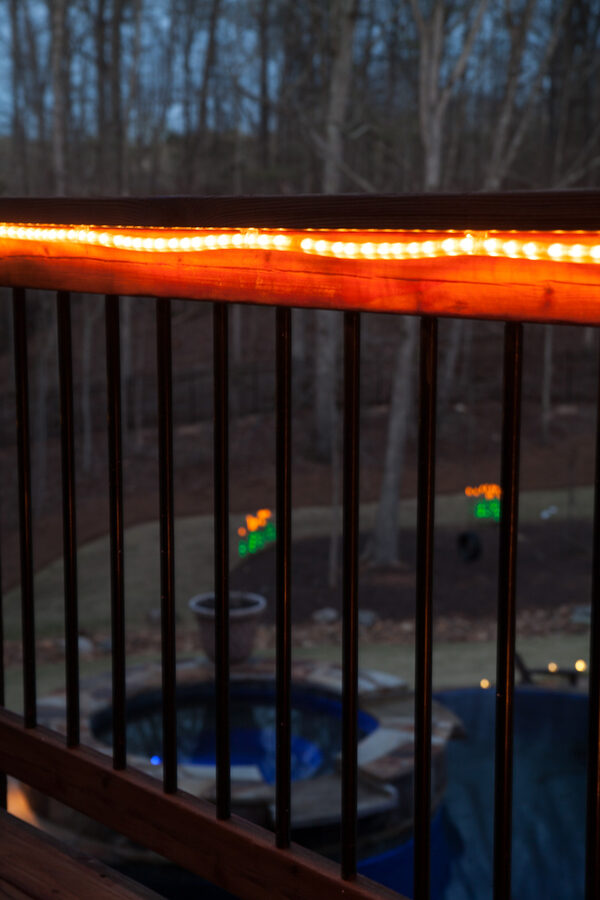 Cast a soft, inviting glow under deck railings with rope lights!