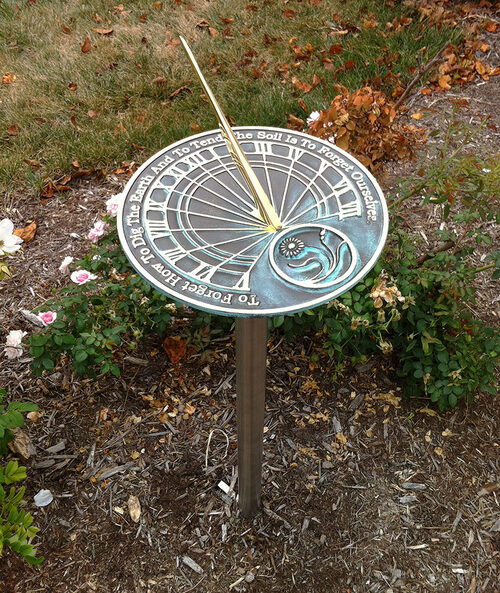 Love this for the garden! Sundial featuring quote from Gandhi.