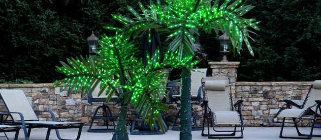 Realistic lighted palm trees - perfect summer pool party lighting idea!