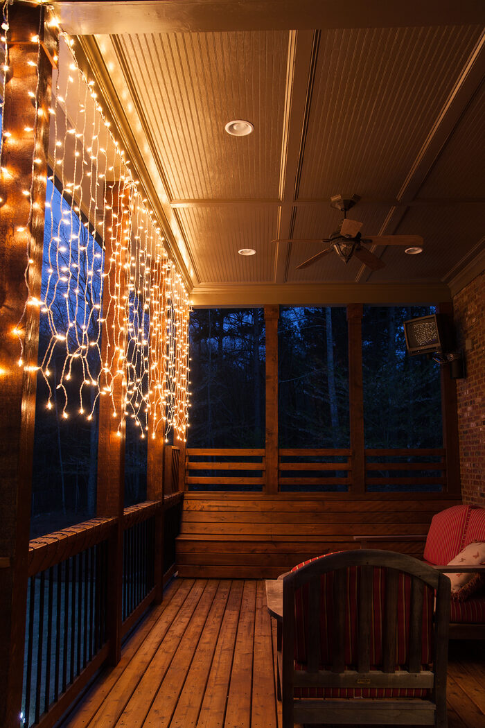 Genius deck lighting ideas: Create a glowing conversation area with curtain lights!