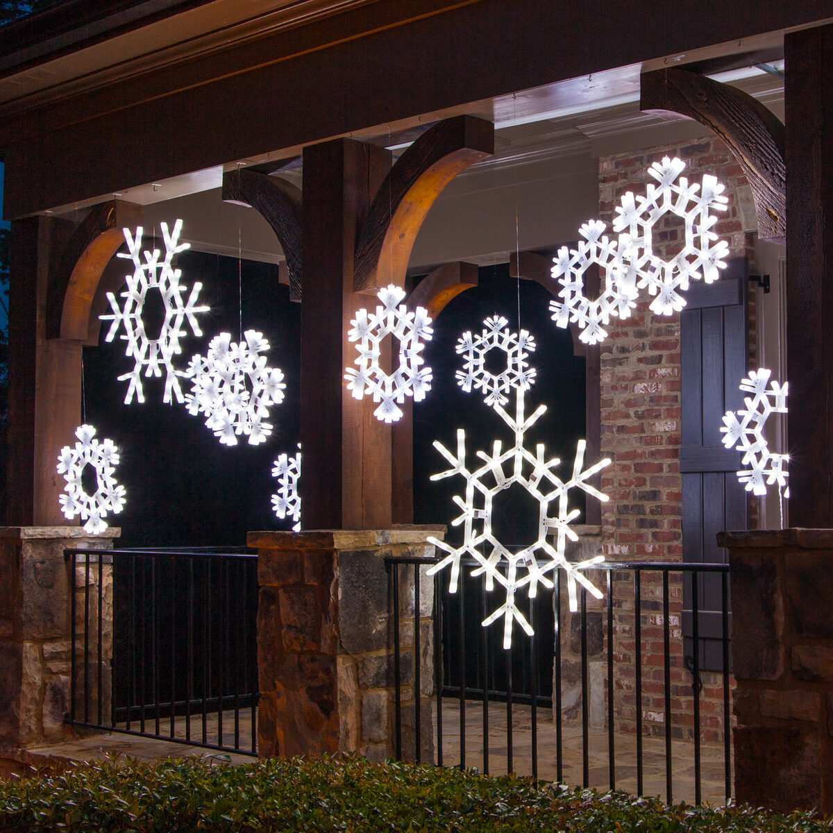 Hang snowflakes across the porch for Christmas. Snowflake Porch Decorations