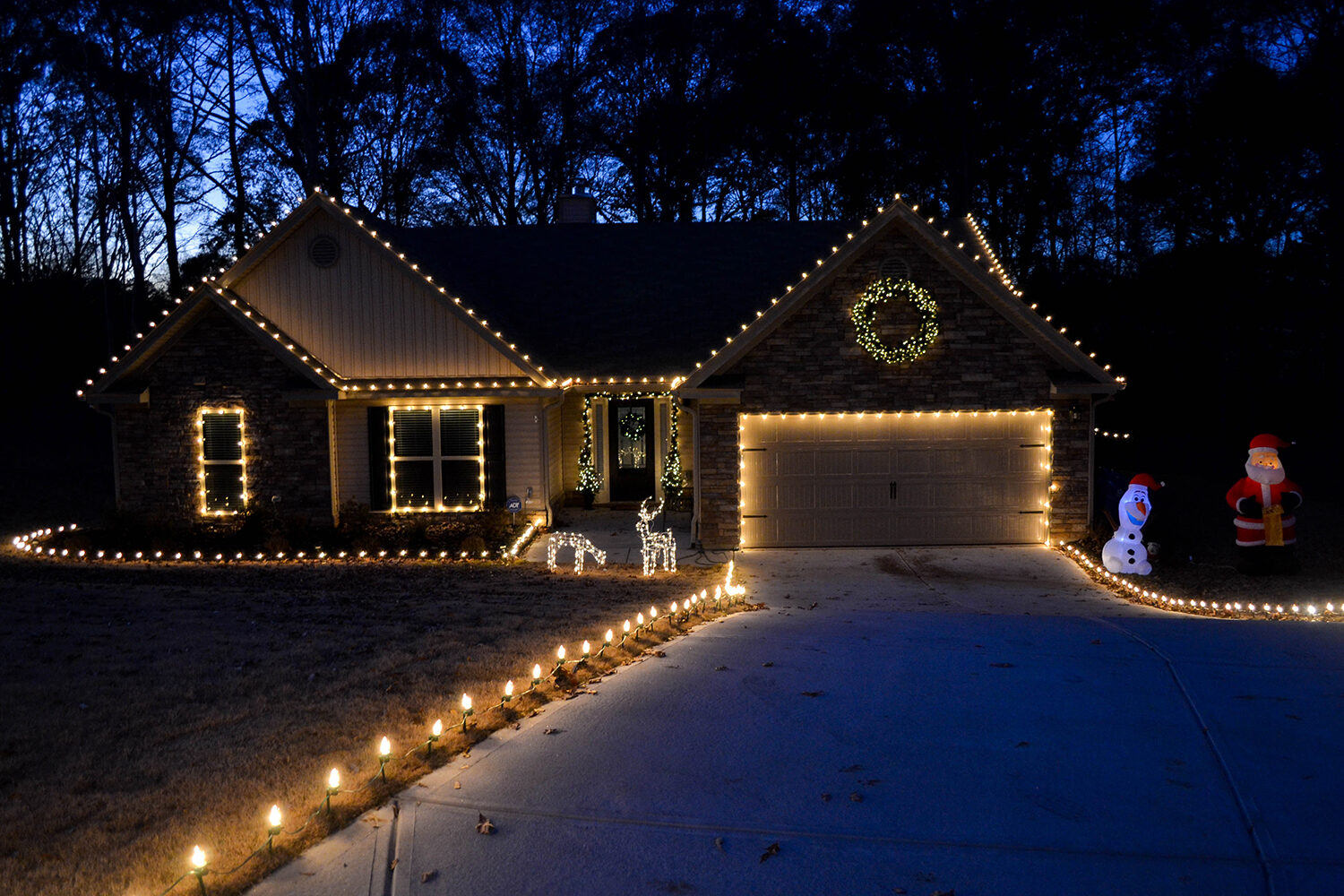 hang christmas lights across the roof and down the driveway