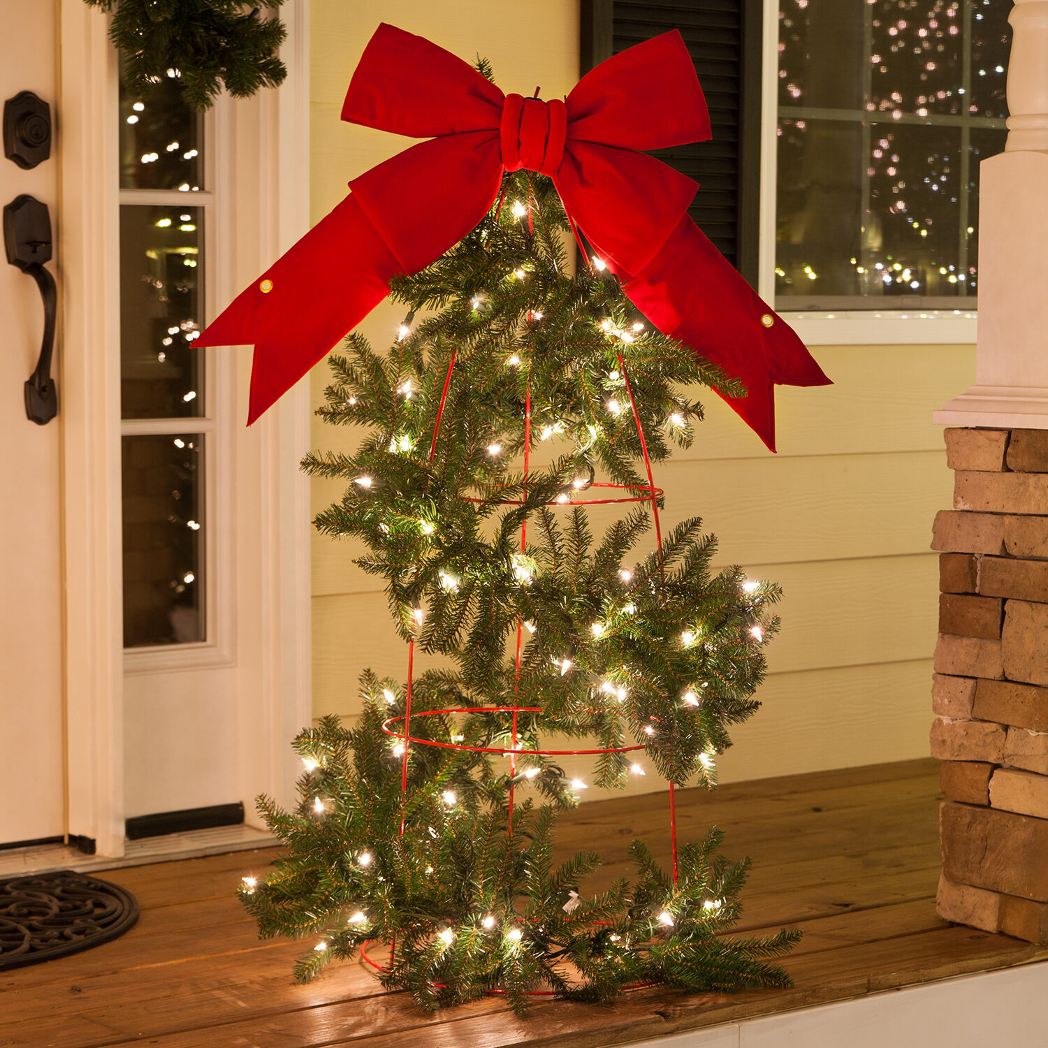 DIY tomato cage Christmas tree - wrap tomato cages with lighted garland then top with a bow!