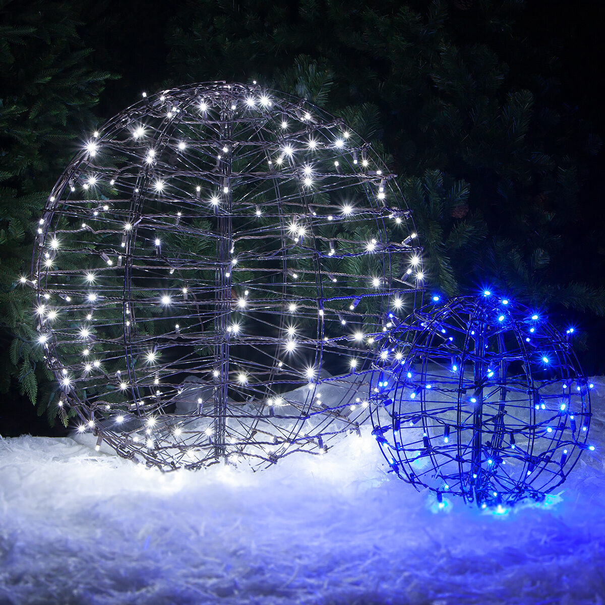 Blue and cool white led lighted spheres in the yard