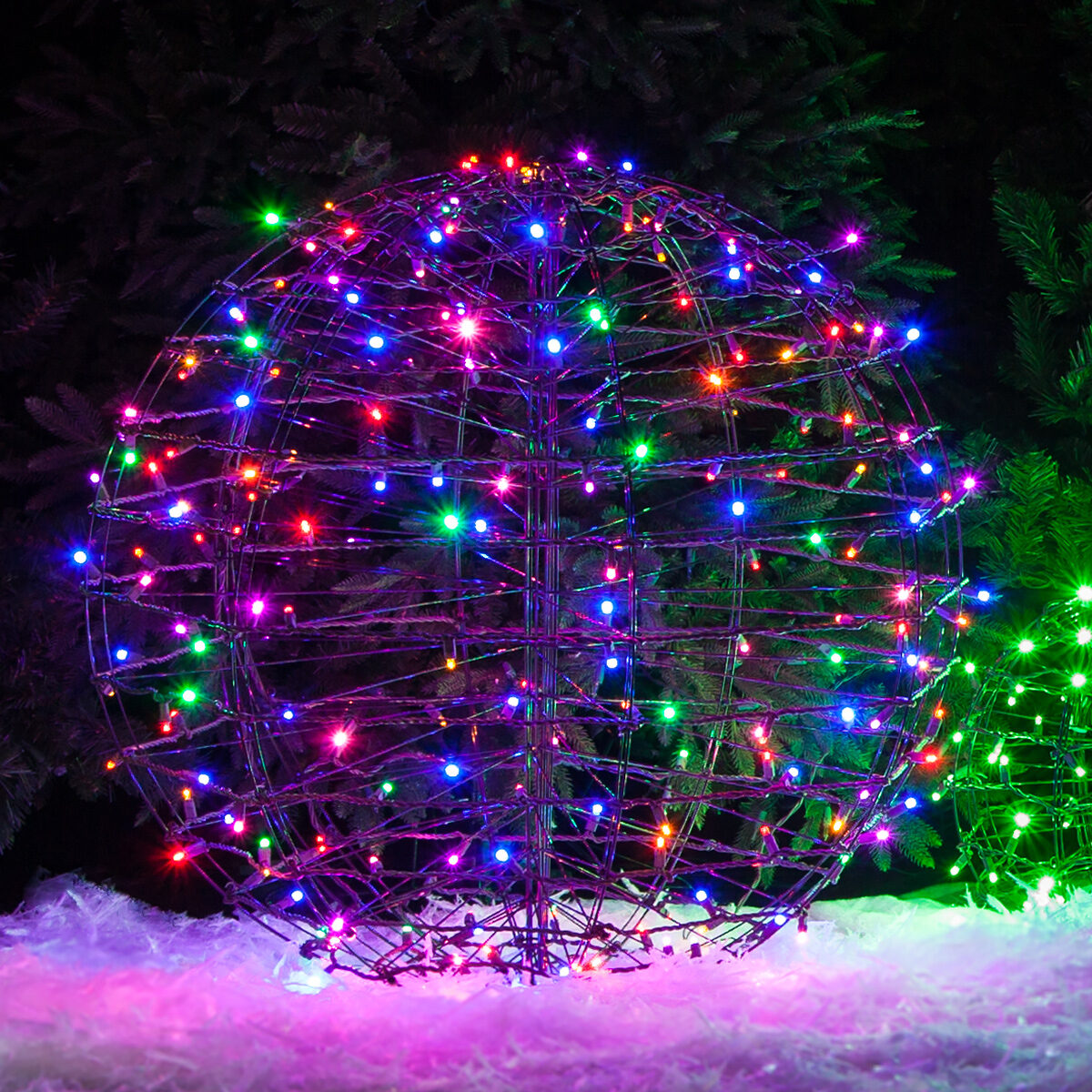 Vivid multicolor led lighted sphere placed in the yard on Christmas.
