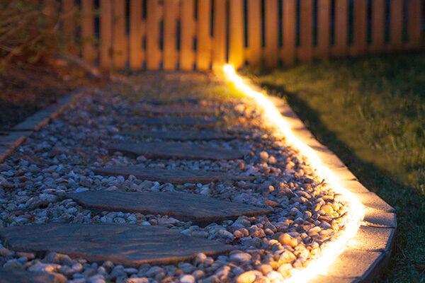 Rope Light Illuminating a Garden Path